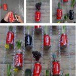 Jardín Vertical realizado con botes de CocaCola