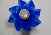 Lámpara realizada reciclando una garrafa y una botella pequeña de plástico. rosa montesa. reciclado creativo